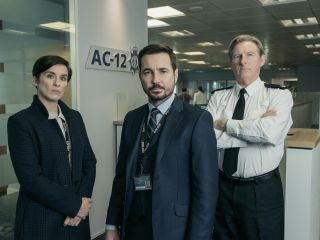 Martin Compston as DS Steve Arnott in Line of Duty (centre), with Vicky McClure as DI Kate Fleming (left) and Superintendent Ted Hasting (right).