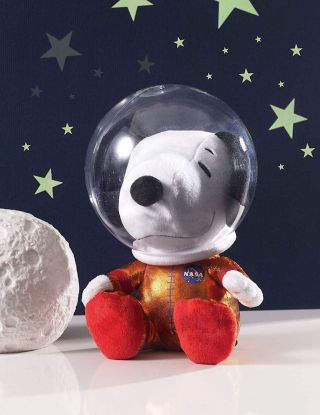 The Astronaut Snoopy plush doll flown to the International Space Station stands 8 inches tall and was made by Hallmark.
