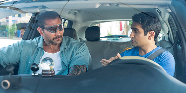 Dave Bautista and Kumail Nanjiani discussing destinations in Stuber