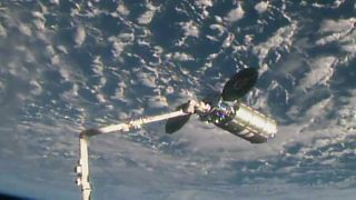 The uncrewed Orbital ATK Cygnus cargo ship S.S. J.R. Thompson is captured by a robotic arm at the International Space Station on May 24, 2018. The Cygnus delivered more than 3 tons of supplies to the station's Expedition 55 crew.