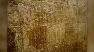 Carved crosses on one of the walls of the staircase descending to the Chapel of St. Helena.