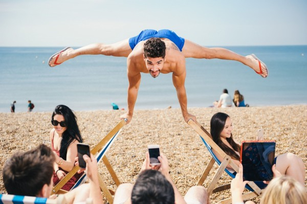 Louis Smith shows off his gymnastic skills on Brighton beach
