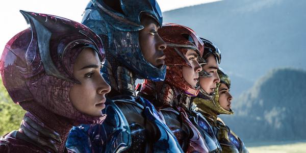 Power Rangers team with helmets open