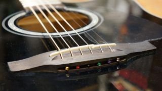 How to lower acoustic guitar strings