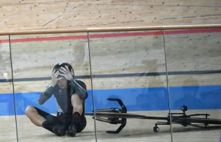 New Zealands Aaron Gate reacts after crashing during the mens track cycling team pursuit finals during the Tokyo 2020 Olympic Games at Izu Velodrome in Izu Japan on August 4 2021 Photo by Greg Baker AFP Photo by GREG BAKERAFP via Getty Images