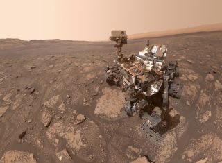 "NASA's Curiosity Mars rover took this selfie at a location nicknamed ""Mary Anning"" after a 19th-century English paleontologist. Curiosity collected three samples of drilled rock at this site on its way out of the Glen Torridon region, which scientists believe preserves an ancient habitable environment."