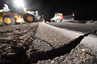 Highway workers repair a hole that opened up after a 7.1-magnitude earthquake rocked an area near Ridgecrest, California on July 5, 2019.