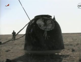 This still from a NASA TV broadcast shows the Soyuz TMA-20 space capsule that landed safely on the steppes of Kazakhstan in central Asia on May 23, 2011 to end the Expedition 27 mission to the International Space Station. The Soyuz landed with Russian cos