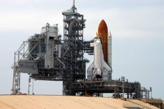 Shuttle Discovery Begins Slow Crawl Off Launch Pad