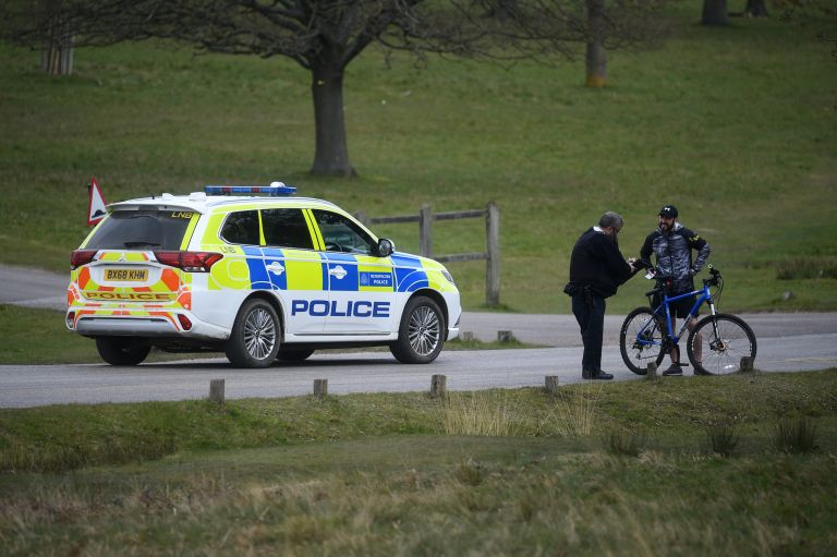 A police office talks to a member of the public in Richmond Park