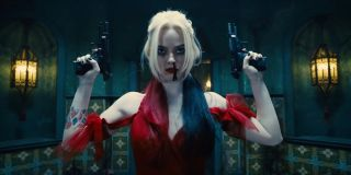 Margot Robbie as Harley Quinn holding guns in The Suicide Squad