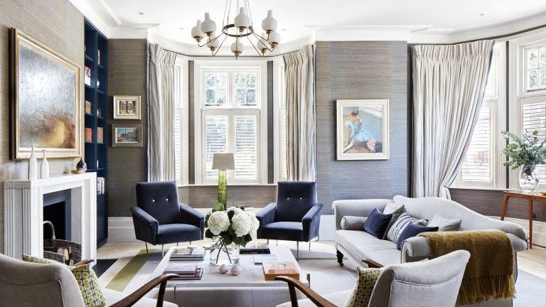 Curtain ideas with grey curtain in a living room with blue velvet chairs