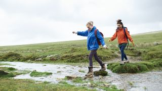 hikers on stepping stones
