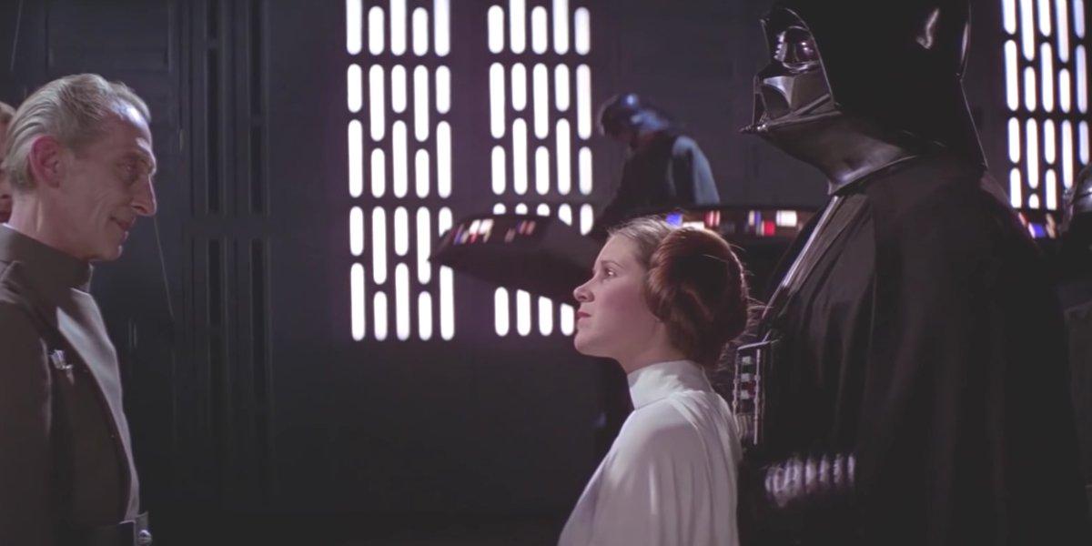 Grand Moff Tarkin, Princess Leia, and Darth Vader in A New Hope
