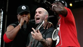 Scott Ian onstage with Chuck D and Flavor Flav in 2007