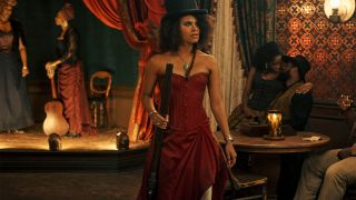 Zazie Beetz in a red dress as Stagecoach Mary in The Harder They Fall