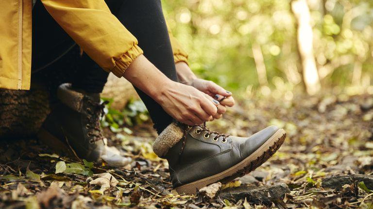 woman tying laces of her best women's walking shoes