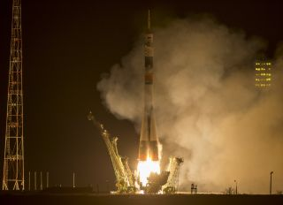 A Soyuz rocket launches toward the International Space Station from Baikonur Cosmodrome in Kazakhstan on March 27, 2015, carrying NASA astronaut Scott Kelly and Russian cosmonauts Mikhail Kornienko and Gennady Padalka. Kelly and Kornienko will stay aboard