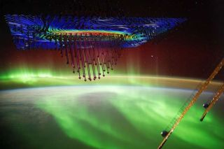 An illustration shows how electrons descend from space on Alfven waves to create the aurora borealis.
