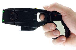 Hand holding a Taser