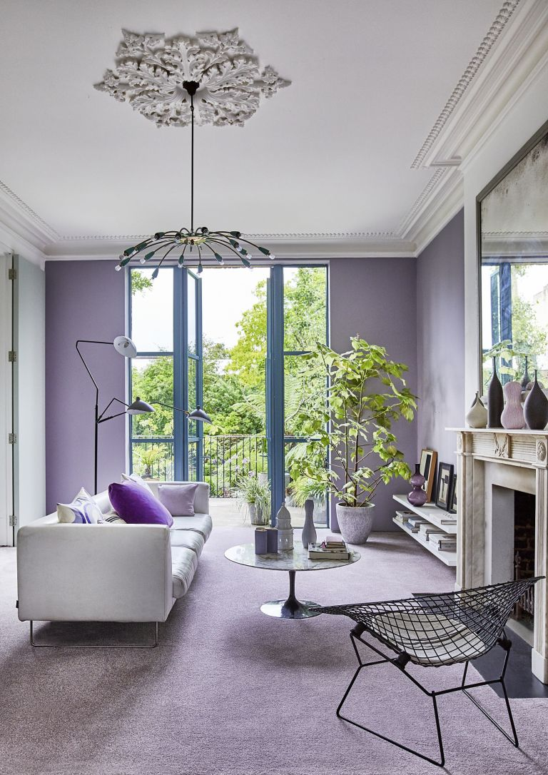 lilac living room with white floating shelves