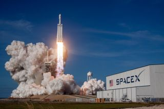 SpaceX's Falcon Heavy launches on its first-ever flight, a Feb. 6, 2018, test mission. The rocket's second launch is scheduled for April 9.