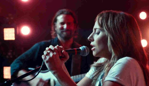 A Star Is Born Lady Gaga sings Shallow with Bradley Cooper in the background in concert