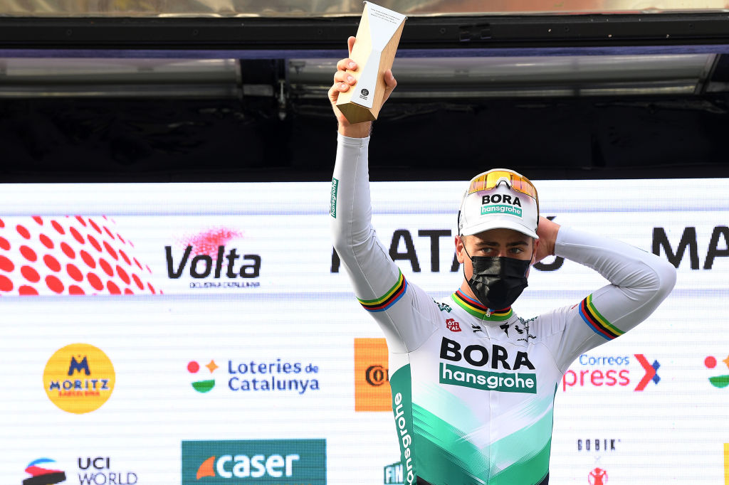 MATAR SPAIN MARCH 27 Podium Peter Sagan of Slovakia and Team BORA Hansgrohe Celebration during the 100th Volta Ciclista a Catalunya 2021 Stage 6 a 1938km stage from Tarragona to Matar Trophy Mask Covid Safety Measures VoltaCatalunya100 on March 27 2021 in Matar Spain Photo by David RamosGetty Images