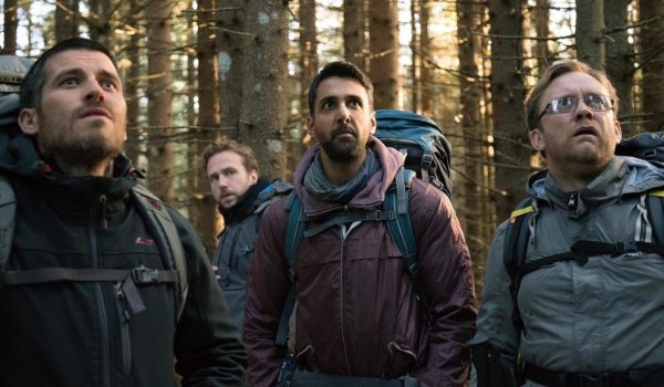 The Ritual guys standing in the woods, looking at something stunned