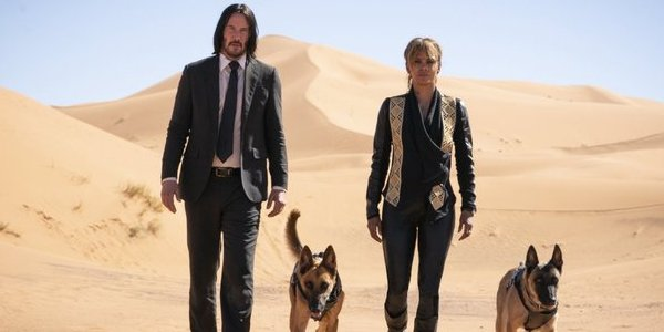 John Wick: Chapter 3 - Parabellum Keanu Reeves and Halle Berry walking the desert with two dogs