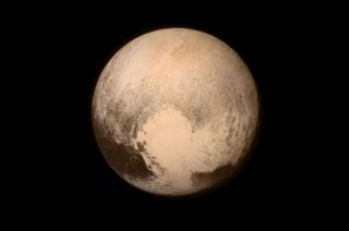 New Horizons' photo of Pluto showing the heart-shaped area now informally named Tombaugh Region.