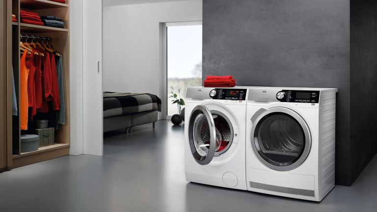 two washing machines in a modern laundry area
