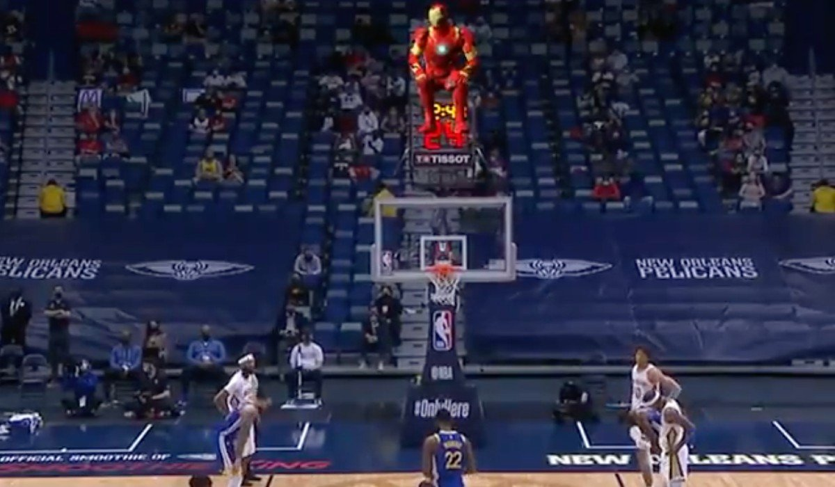 Iron Man on top of the shot clock