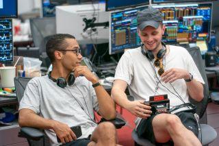 Mickey Down (l.) and Konrad Kay on the Industry set.
