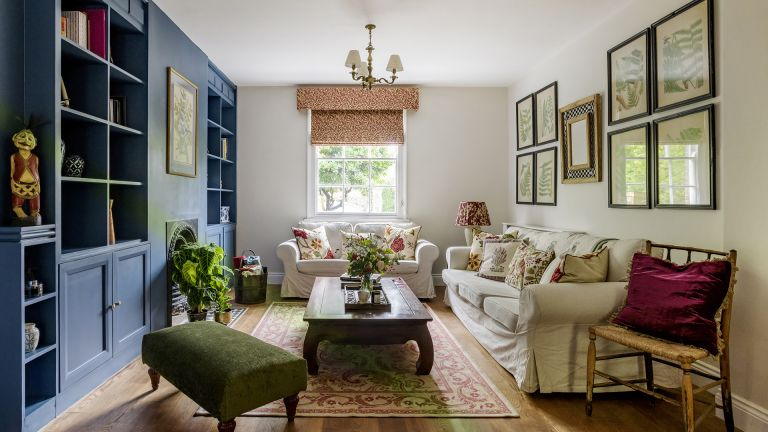 open plan living room with blue built in bookshelves and white sofa