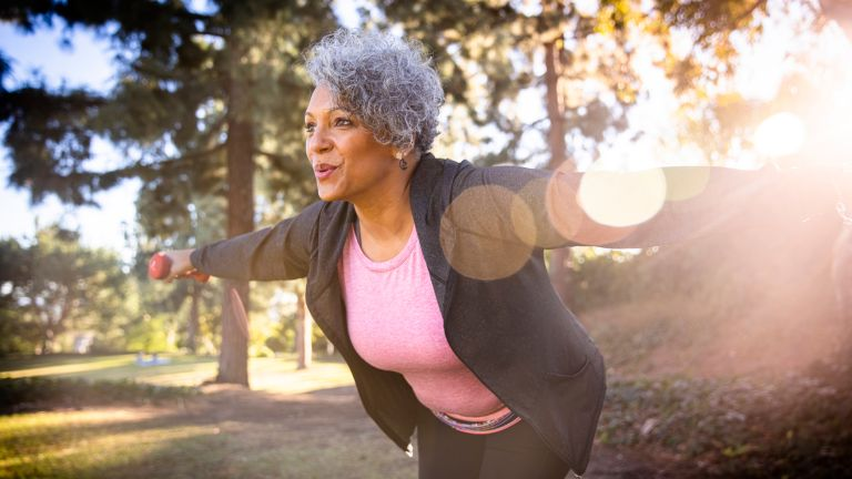 Older woman exercising in nature