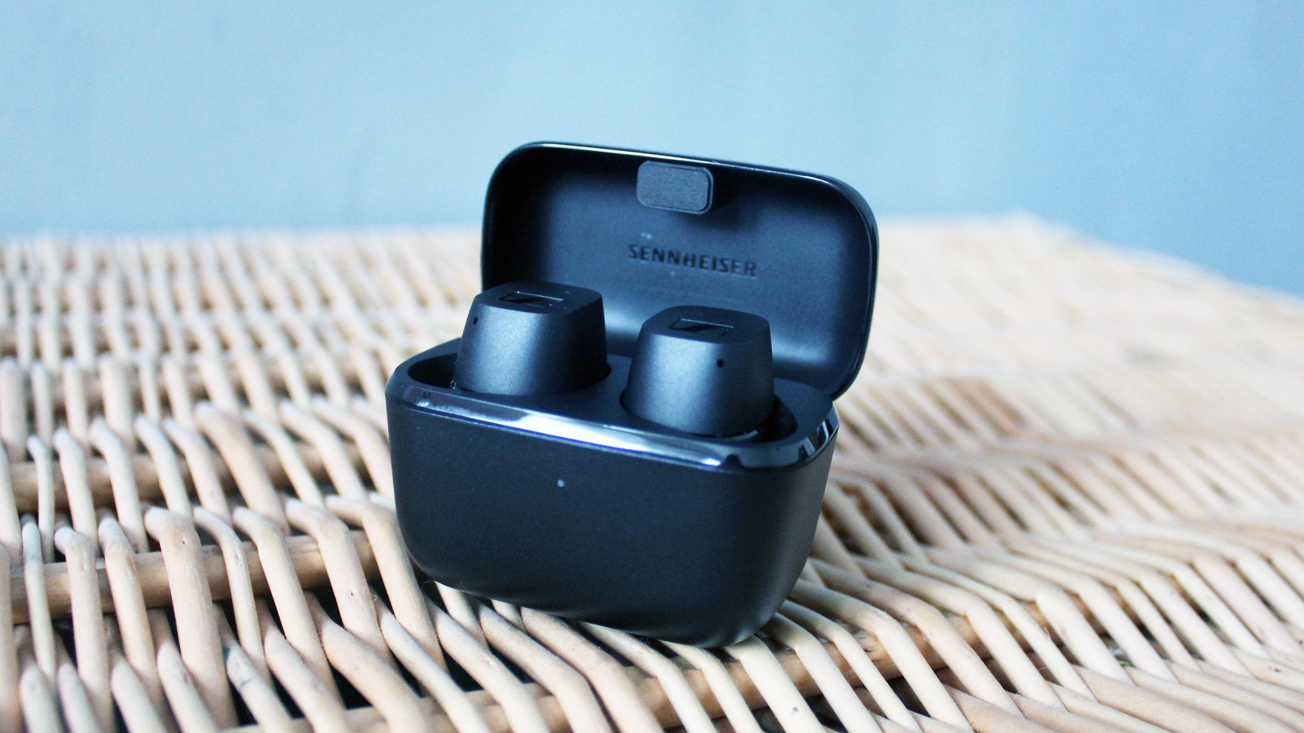 sennheiser cx true wireless earbuds in their charging case on a wicker background