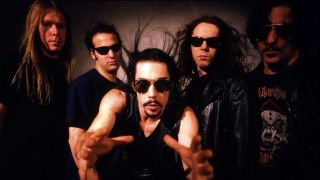 A studio shot of Monster Magnet, Dave Wyndorf at the front with his hands outstretched