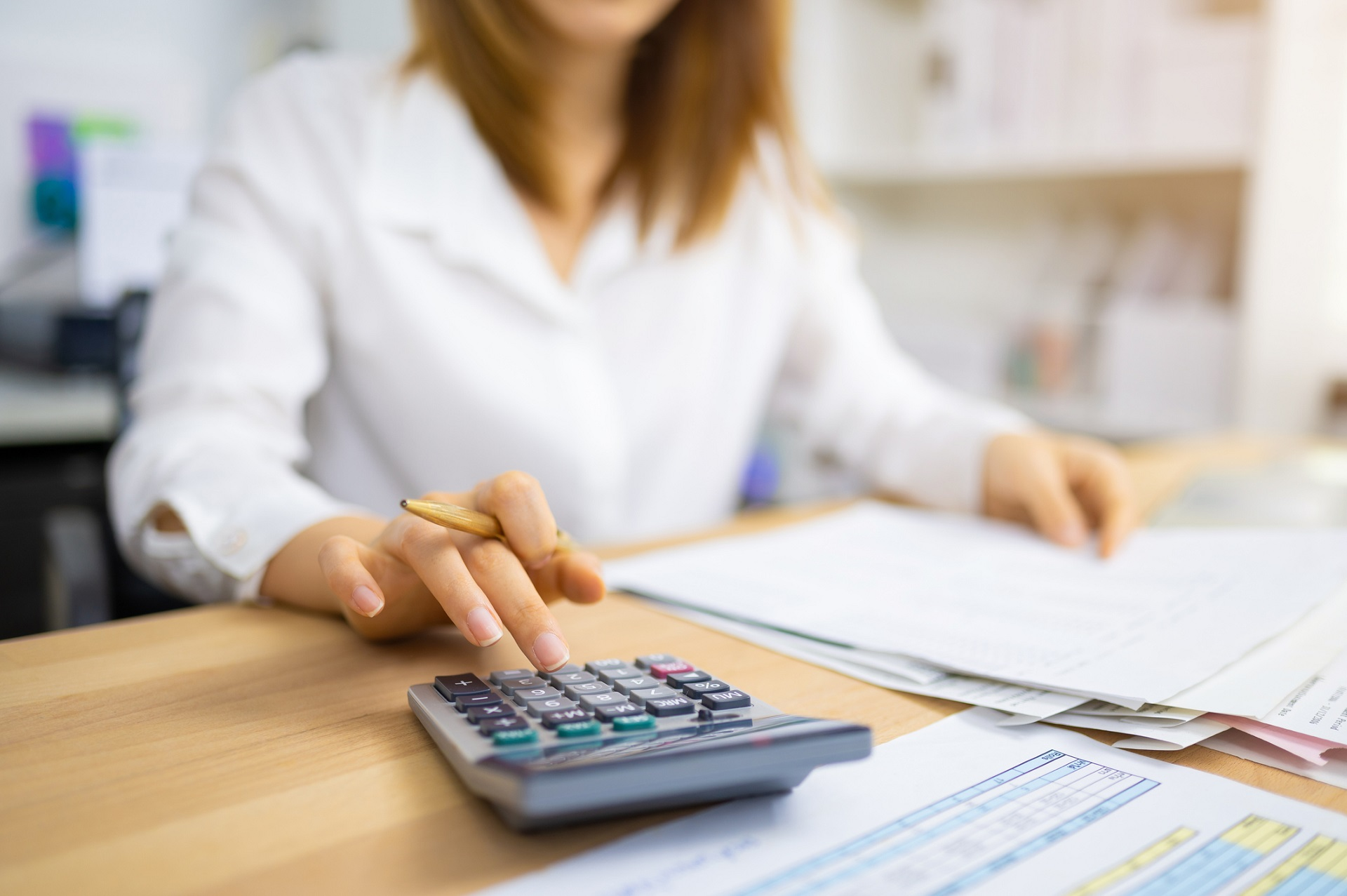 Woman audits business paperwork for PCI compliance