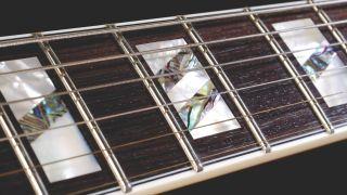 Close up shot of a guitar's fretboard