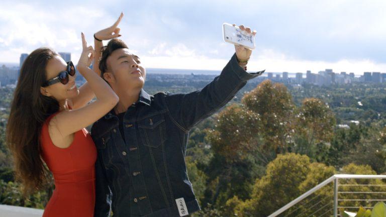 "Kelly Mi Li and Kane Lim in episode 1 ""Necklacegate 90210"" of Bling Empire: Season 1."