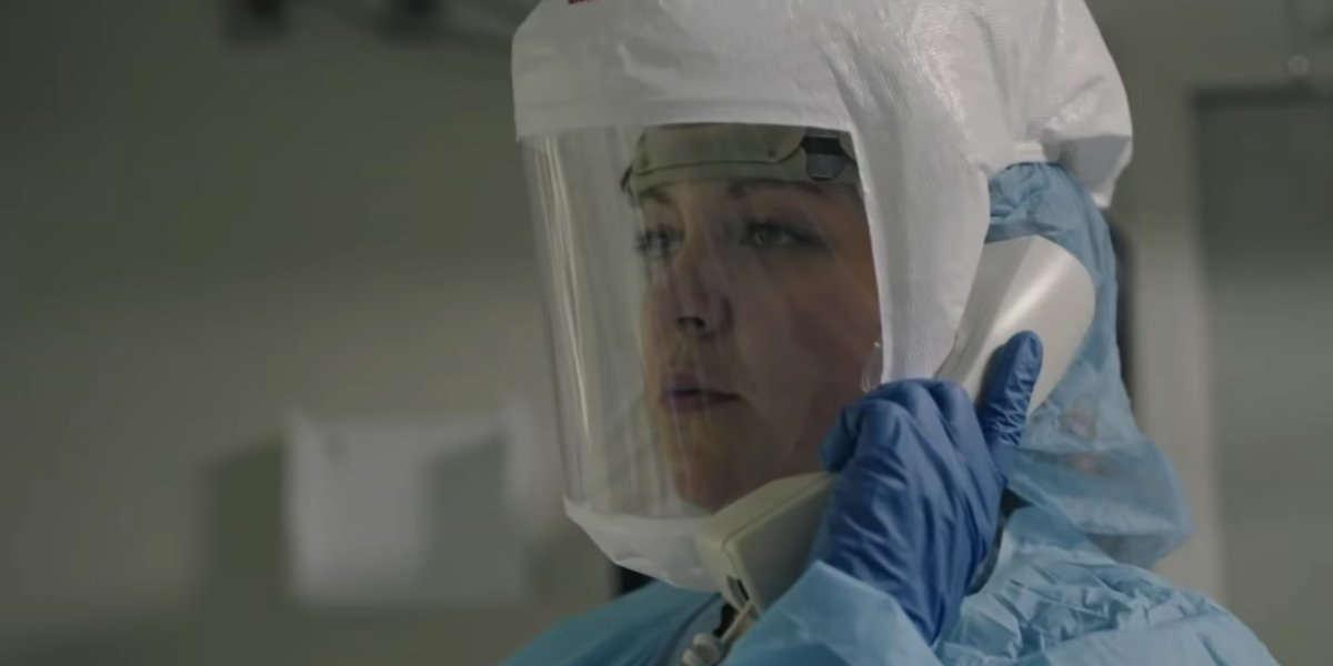 A doctor in protective gear in Totally Under Control
