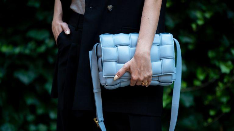 street style model holding Bottega Veneta designer bag