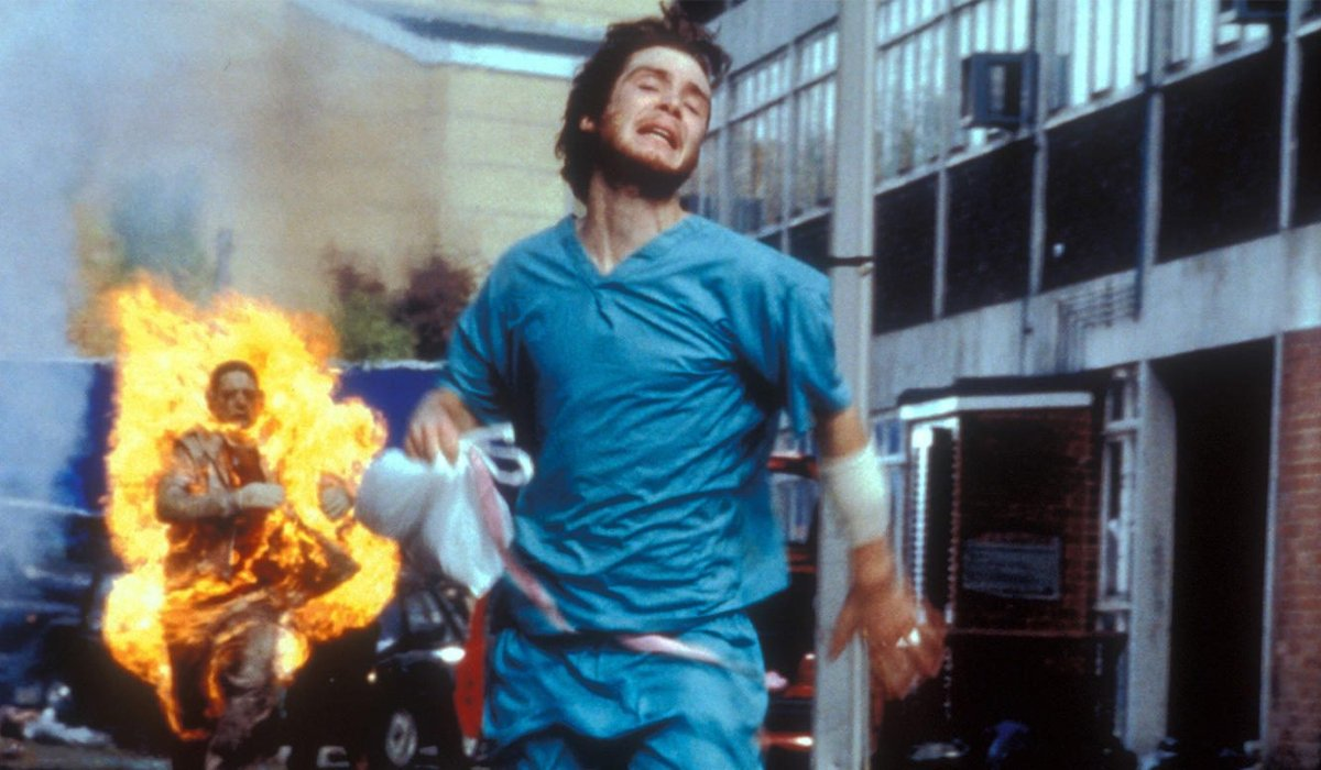 Cillian Murphy runs from a burning Infected in 28 Days Later.