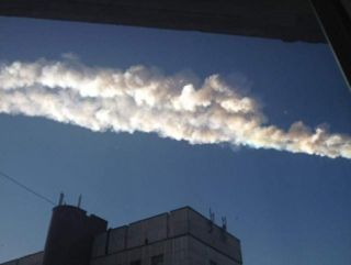 Meteor trail occurs over eastern Russia on Feb. 15, 2013.