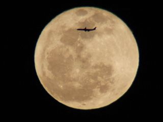 Airplane and Full 'Worm' Moon Over L.A.