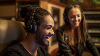 Man and woman listening to AKG K371 headphones