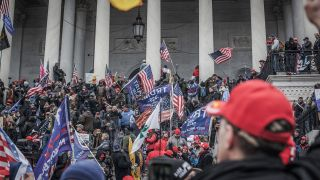 Trump supporters take the steps on the east side of the US Capitol building on January 06, 2021 in Washington, DC.