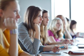 Teens sit in a high school classroom