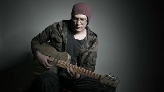 Devin Townsend playing acoustic guitar